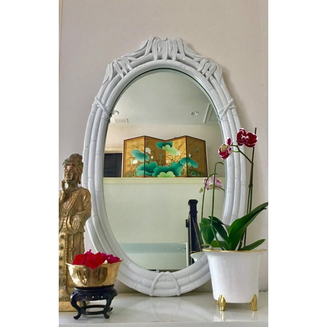 Large oval vintage lacquered faux bamboo mirror. Whew, what a mouthful! This mirror is not as frequently seen as other...