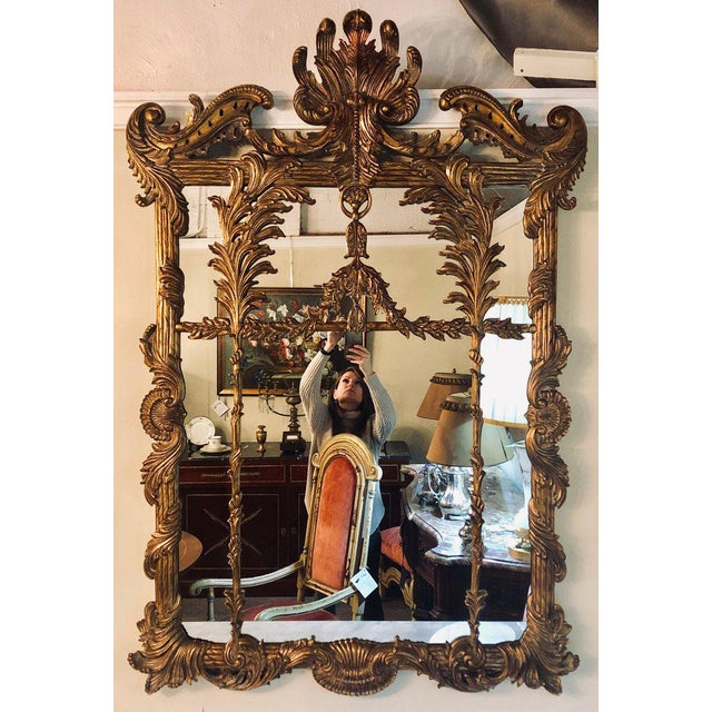 La Barge Italian Style Foliate giltwood wall, console or over the mantle mirror. The clear center mirror panel in a leaf...