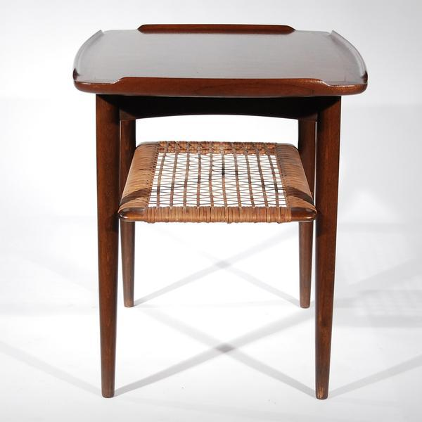 Offering a wooden kitchen prep table with woven shelf