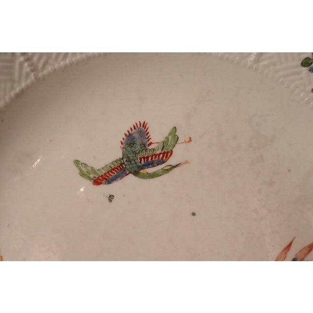 Rare antique Meissen plate, circa 1740, decorated in the centre with a flying crane, dragon and insect, the rim with...