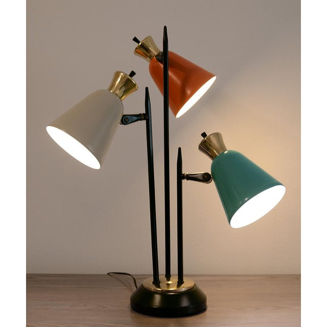 One of the coolest Mid-Century Modern table lamps you'll ever see! No mark found but very likely a product from the 1950s...