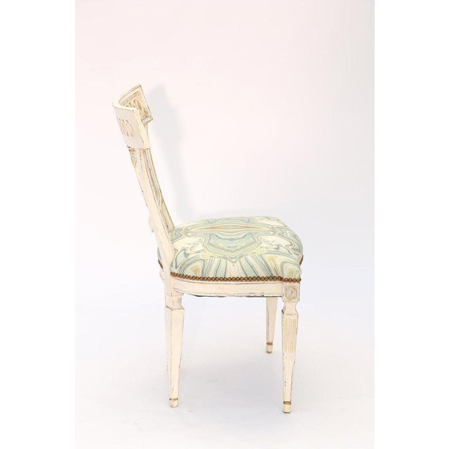 Side chair, having a painted finish, its toprail with pierced guilloche design, the spat a beaded, oval, cartouche,...