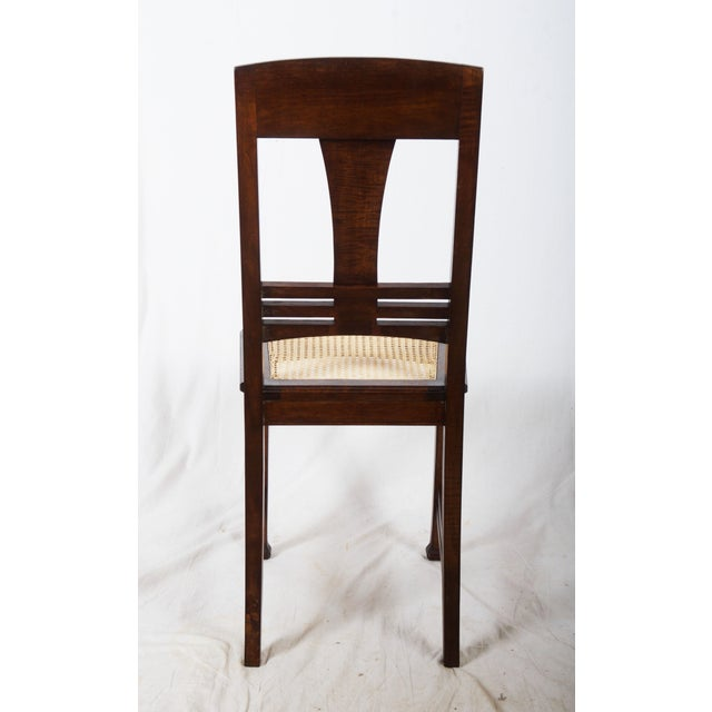 Nut wood construction with a canned seat. Made in Germany between 1900-1910 Four pieces available, delivery time 2-3 weeks.