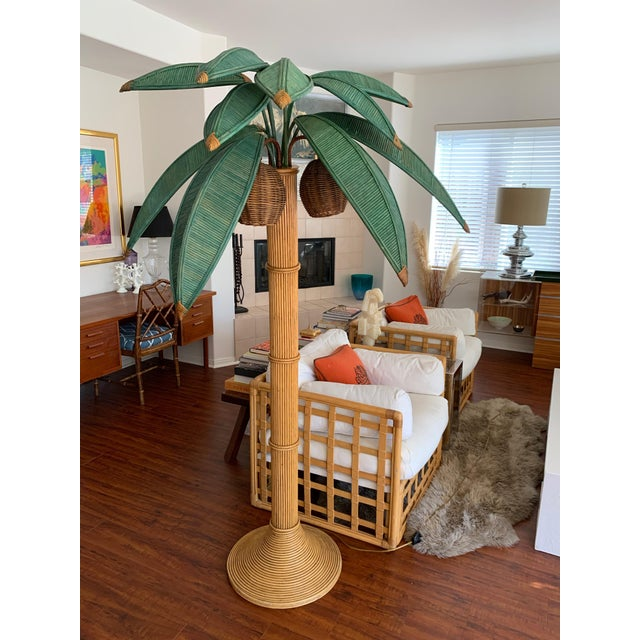 Sculptural rattan palm tree floor lamp by Mario Lopez Torres. Excellent vintage condition. In-line power switch and three...