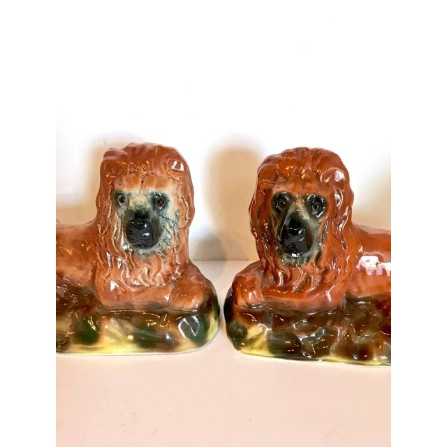 This is a great pair of late 19th century, Staffordshire lions. Both lions are in overall very good to excellent condition.