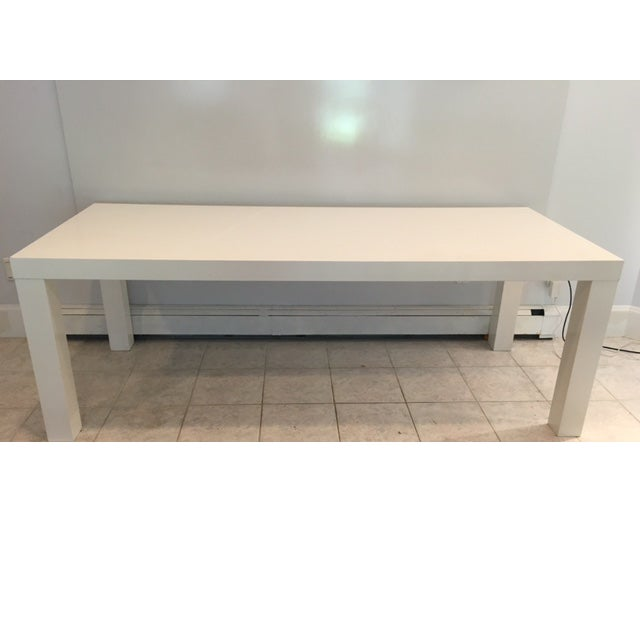 Offered is a large wooden lacquered table. This beautiful Modern style piece can be used in a variety of rooms!