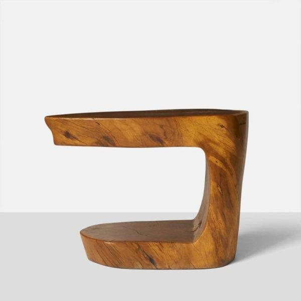 A pair of cantilever shape side tables by Hugo Franca made from naturally fallen Brazilian hardwood and signed by the...