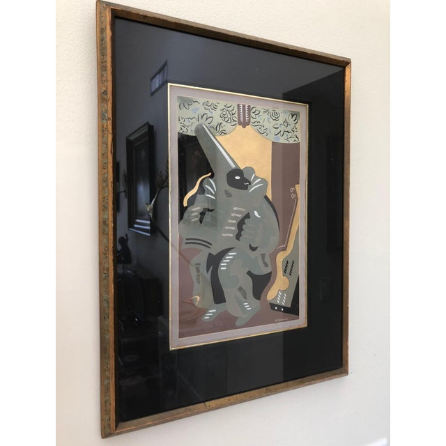 "This rare pochoir by Gino Severini is titled ""Polichinelle au livre"" which translates to ""Polichinelle with a Book""and..."