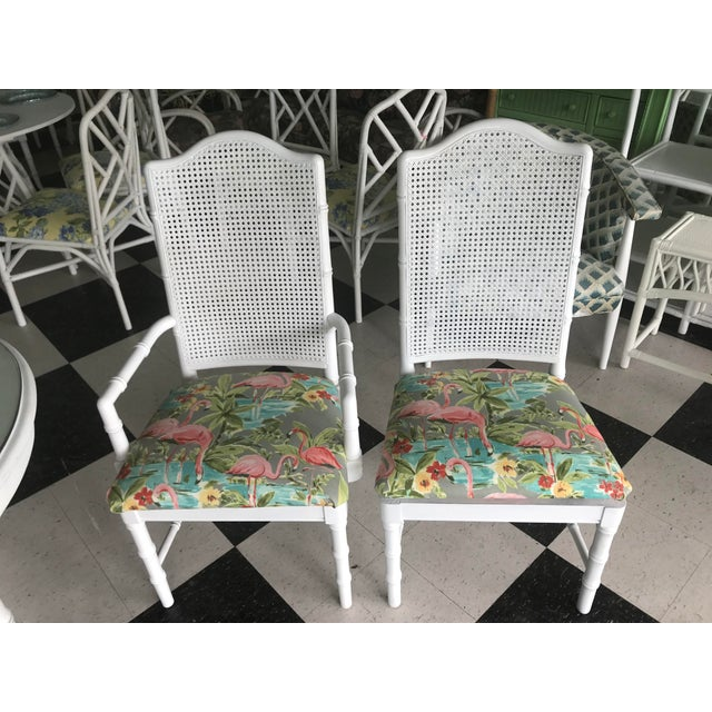 Faux bamboo dining set is in good vintage condition. Set includes 4 side chairs and 2 arm chairs. Table has a leaf and...