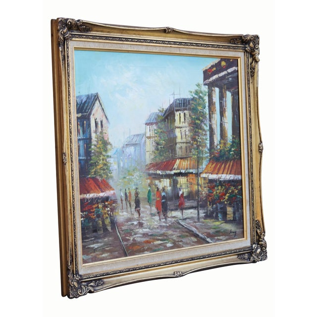 A competent impressionist oil on canvas depicting a French street scene. Street vendors selling flowers frame brightly...