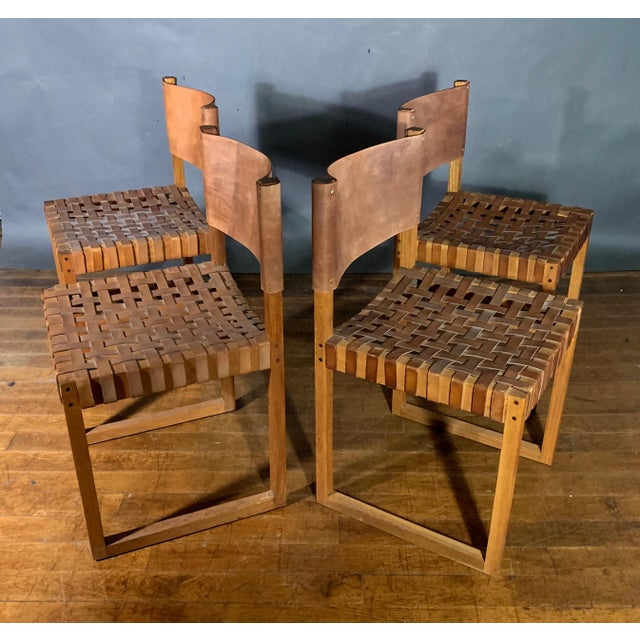 An unusual set of oak dining chairs, likely of Danish design from the 1970s. Square frames have generous proportions....