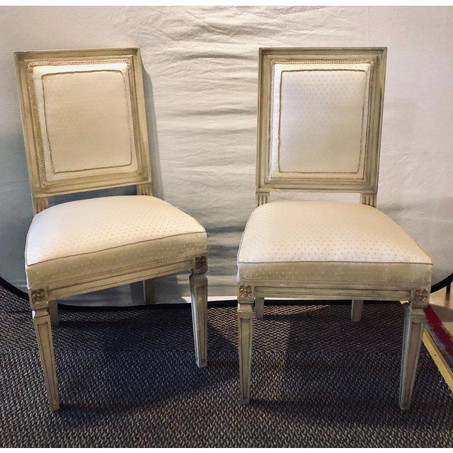 Set of twelve Maison Jansen style faux linen paint decorated with new upholstery dining chairs. Each in a new upholstery...