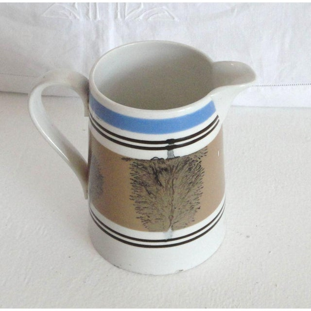 Fantastic form and condition mocha cream or milk pitcher. This wonderful striped & decorated pitcher is in great condition.