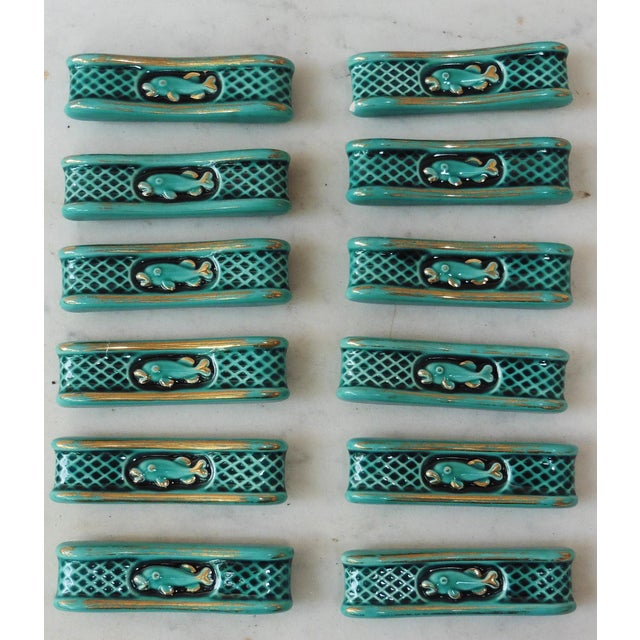 A rare set of 12 green Majolica knife rests with fishs circa 1950.