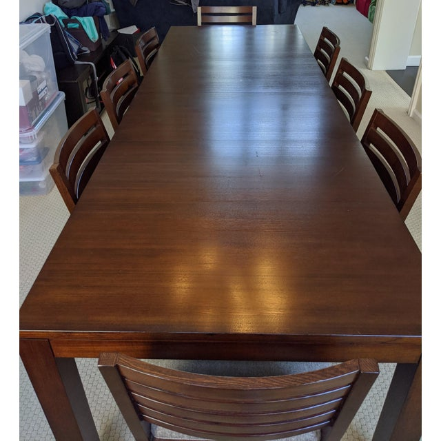 Great dining table from Ethan Allen that seats 8 (10 if you squeeze). Manufactured in 2011. Other than the small stain,...