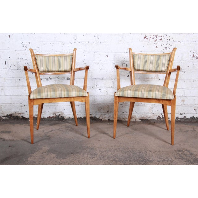 An exceptional pair of mid-century Swedish Modern armchairs designed by Edmond Spence. The chairs feature sleek...