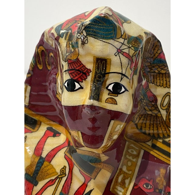 Marvelously inventive figurine - a sculpture material covered with a Hermes style fabric and embelished even further with...