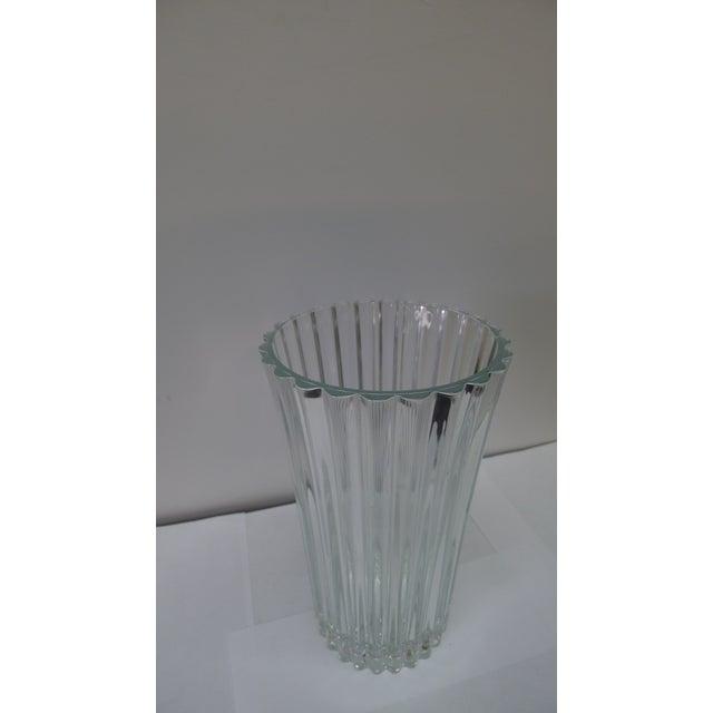"Heavy crystal floral vase. Marked ""France"" underside. 4.5 diameter base, 5.75 diameter at top."