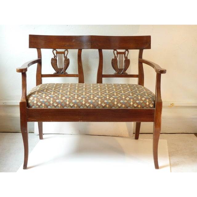 "French 19th C. Walnut settee with upholstered drop in seat, carved motif of harp & swans, sturdy, height of seat 19""."