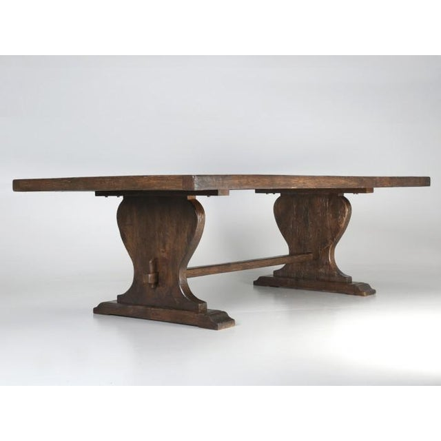 Vintage French Oak Dining table, that comfortably seats a party of (12) for dinner. The ends of the vintage French oak...
