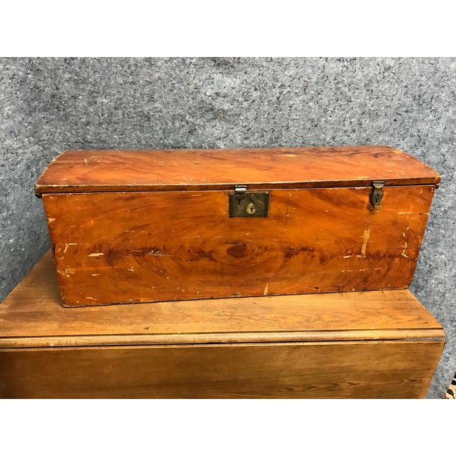 An antique barrel top blanket or storage chest from France that has its brass locks and iron handles. The owner's name is...