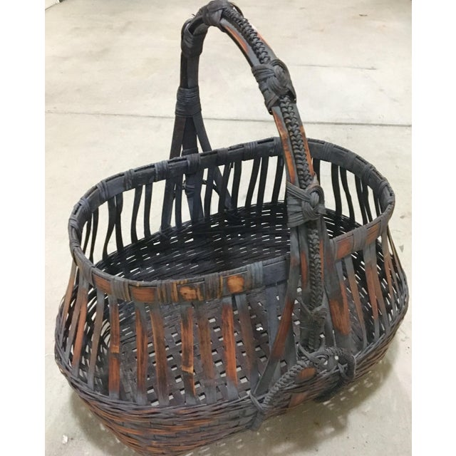 """Exceptional craftsmanship and rare to find this huge basket just waiting for a show stoping arrangement. Measures a lofty 28"""""""