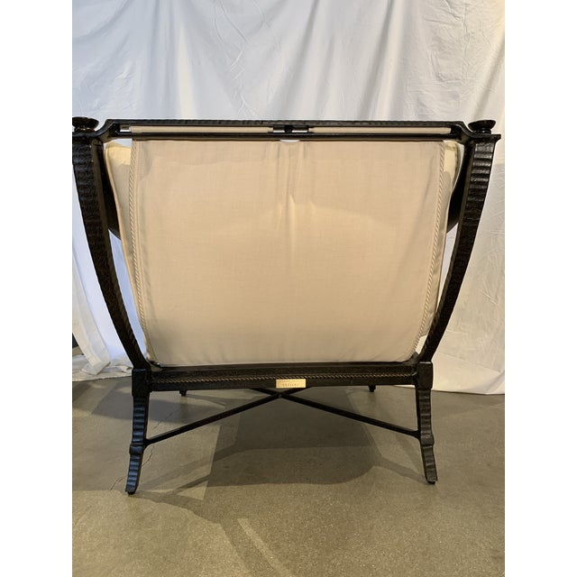 An outdoor arm chair constructed of powder coated aluminum in a Cordoba finish. The cushion and back pillow are filled...