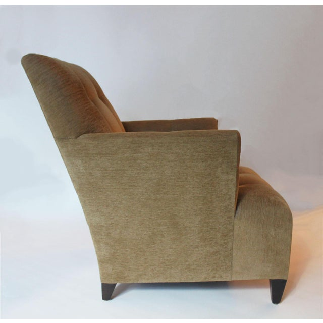 Silk chenille fabric from Donghia Fabrics with walnut legs. The gentle splayed arm and tufted arm and seat are very...