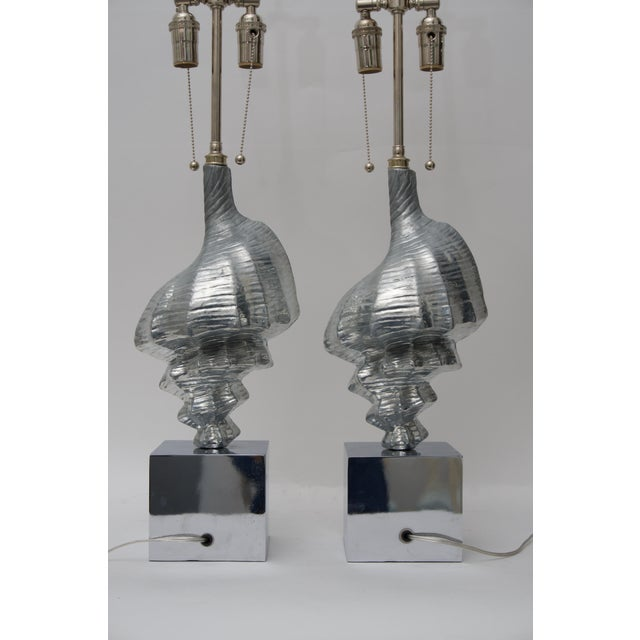 This stylish pair of seashell-form table lamps are very much in the style and quality of pieces created by Arthur Court....