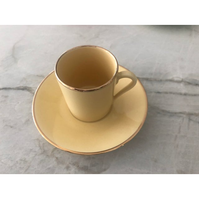 A pristine set of 12 Apilco Porcelaine multi-color gold-banded espresso cups designed by Yves Deshoulières, made in...