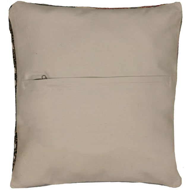 This pillow is made with a vintage handwoven Turkish Mid-Century rug fragment. It has a cotton back and a zipper closure....