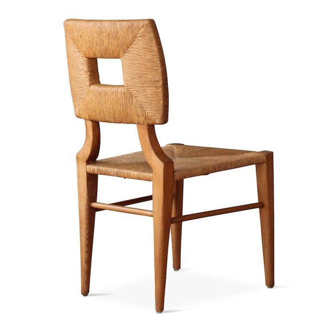 A re-edition of a chair bought at a Hollywood memorabilia auction and attributed to legendary designer, T. H. Robsjohn-...