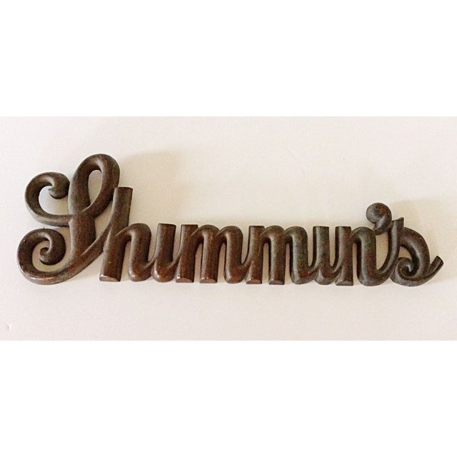 This vintage shop sign has a great look. It is made of bronze metal in a script style font with the name 'Shimmin's'. This...