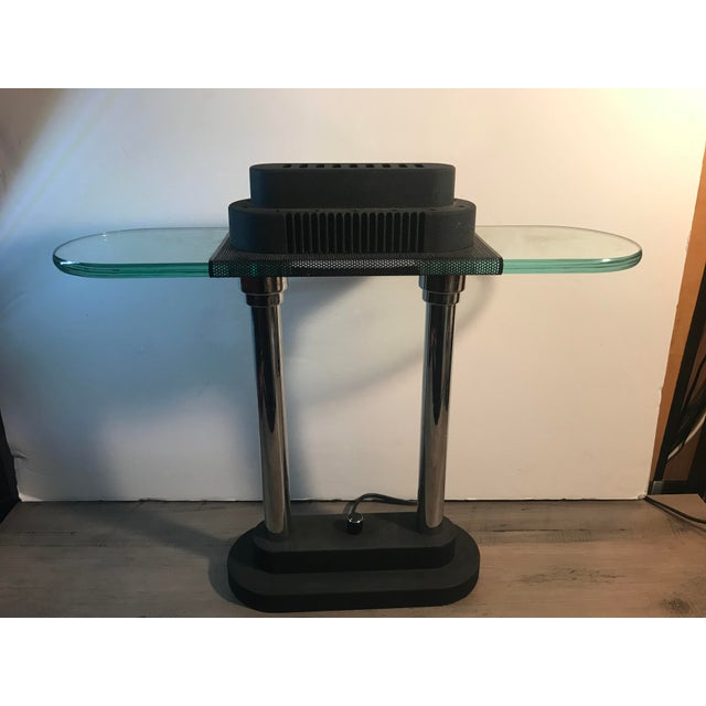 Industrial modern stainless steel table, and glass shade lamp. In excellent vintage working condition with all original...