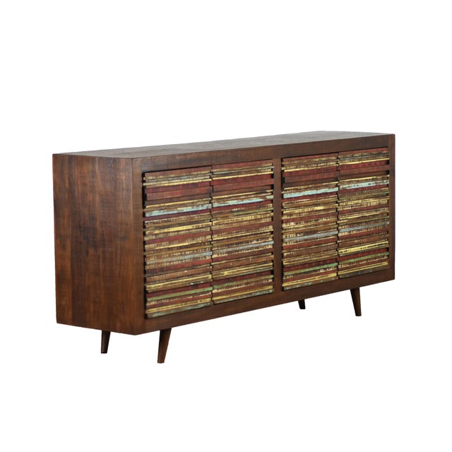 Meticulously hand crafted with solid peroba wood, this mid-century modern inspired 4 door cabinet will add a refined and...
