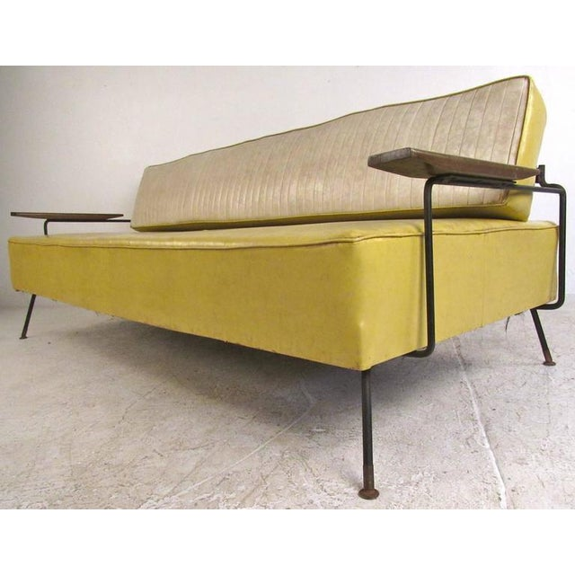 """This unique vintage daybed features durable vinyl covering with cast iron frame. Spacious seating area with a 17"""" seat..."""