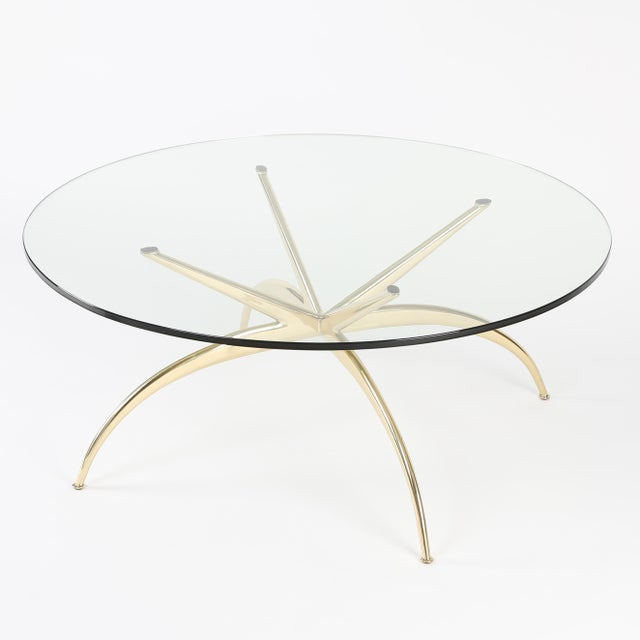 This 1950s Italian solid-brass coffee table features four gracefully arched and tapered legs connected to four straight...