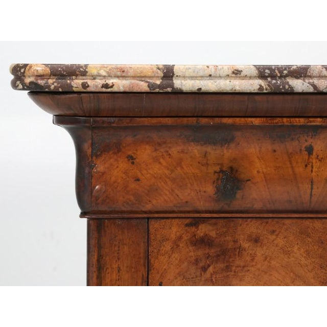 Antique French Louis Philippe style commode, constructed of bookmatched burl walnut, complimented by an exquisite piece of...