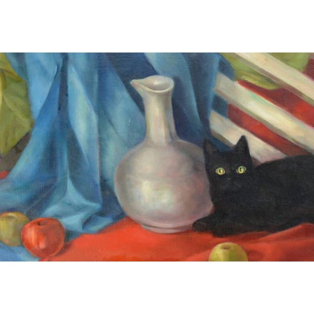 Charming still life of fruit, vase and black cat by Monterey artist Joseph Tanous (American, b. 1925), circa 1970. Signed...