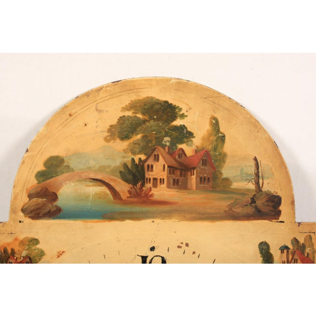 A 19th-century hand-painted English clock face featuring a homestead motif.