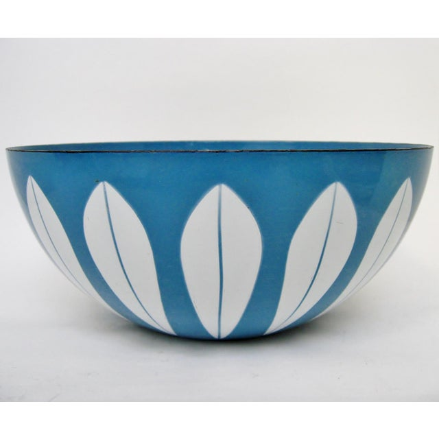 Mid-century Norwegian enamelware serving bowl with white lotus design on blue glaze. No maker's mark. There is light wear...