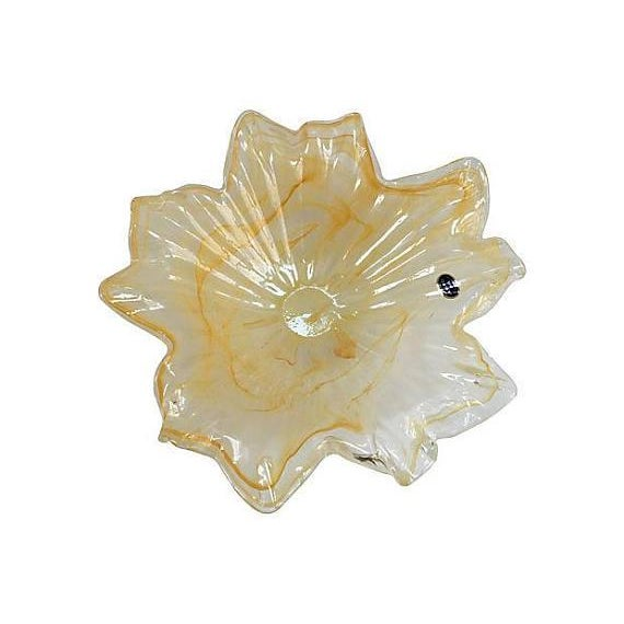 Gorgeous Italian handblown Murano glass centerpiece bowl with translucent and iridescent coloring. Maker's label attached....