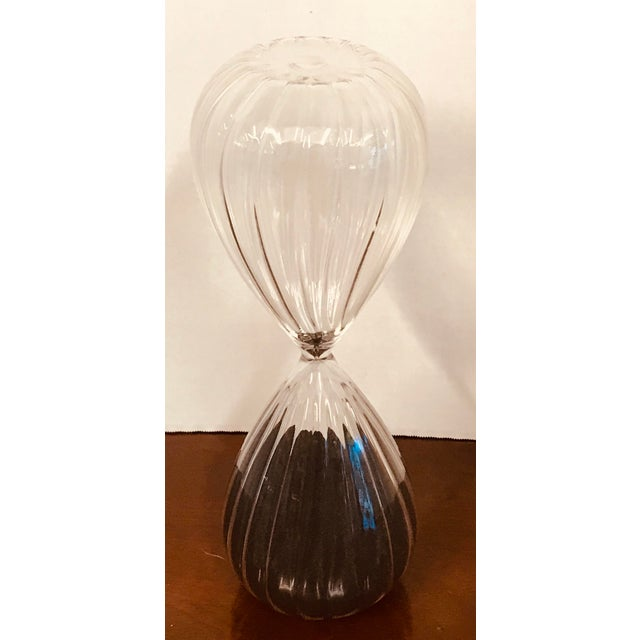 Stunning hourglass decor piece. In excellent condition No cracks, no chips