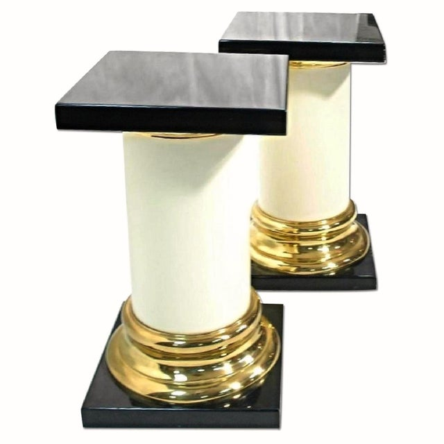 On offer on this occasion is a pair of striking, luxurious Mastercraft pedestal tables. Lacquer and Brass. Unmarked. Black...