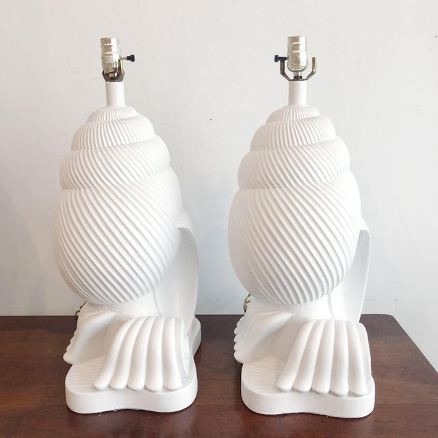 Large pair of shell and wave plaster lamps signed by Artmaster. Recently restored n white. Lamps have original wiring.