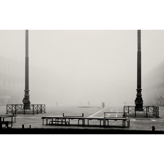 Two of the three flagpoles at the eastern end of Piazza San Marco, Venice. A freezing cold, early February morning,...