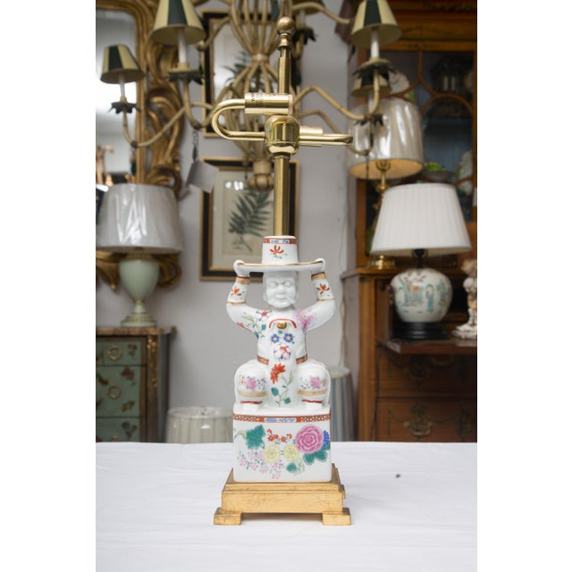 This unique figure of a Chinese warrior is delicately hand-painted and serves as a delicate and sophisticated table lamp....