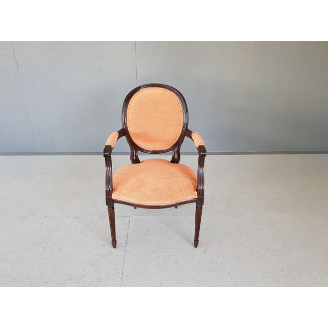 French Louis XVI Style Vintage Medallion Peach Velvet Arm Chairs with Hand Carved frame and solid tapered, fluted legs....
