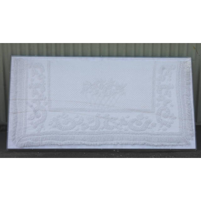 This amazing all handmade and hand quilted early 19th century trapunto sham with a wonderful interesting swag inner...