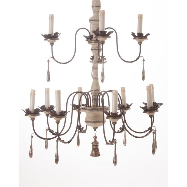 Large painted 12 light chandelier of stunning size and finish! Newly made and imported from Italy. This fun chandelier is...